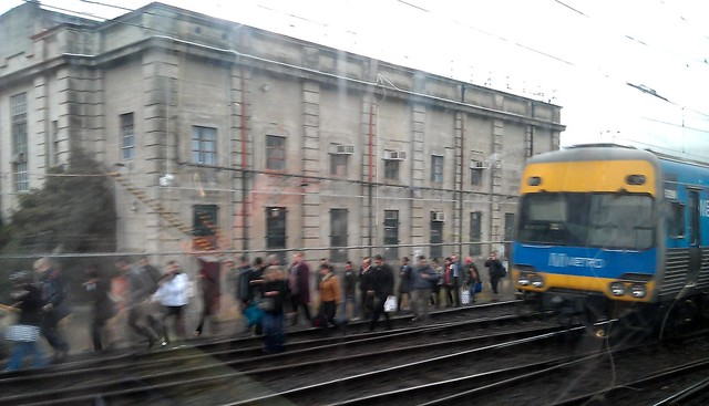 Passengers evacuate a train at Caulfield, 25/6/2012