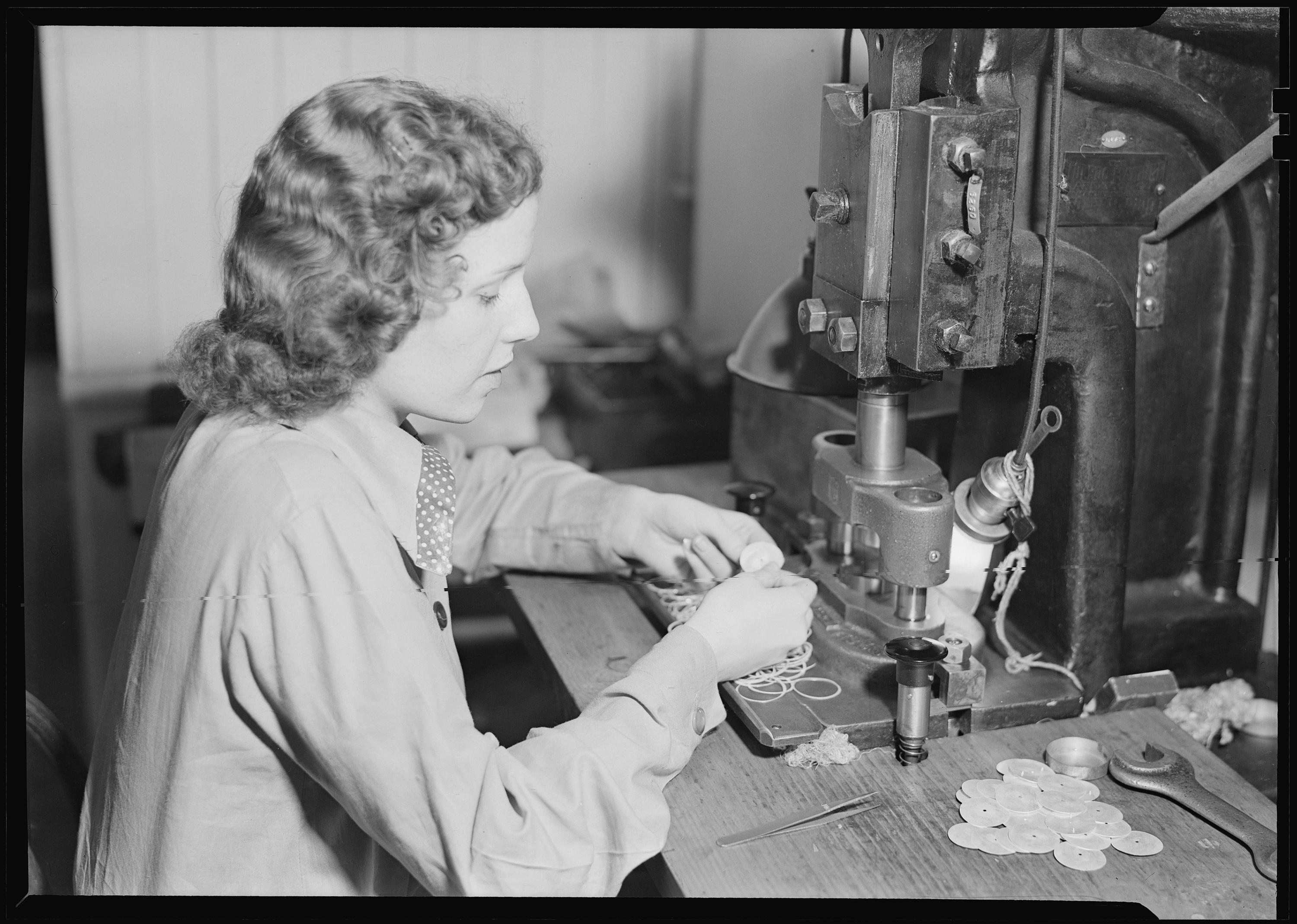 Hamilton Watch. Operation - shaving dial blank - simple machine operation. Note two safety devices on machine, 1936