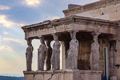 Statues on the Porch of the Caryatid's overlooks Athens from the Acropolis. #travel #Greece #sunset