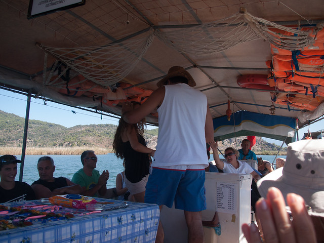 Tourists dancing on the boat