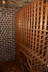 wine cellar(0.0), winery(0.0), iron(0.0), floor(1.0), wall(1.0), wood(1.0), room(1.0), interior design(1.0), design(1.0), hardwood(1.0), brick(1.0), flooring(1.0), brickwork(1.0),