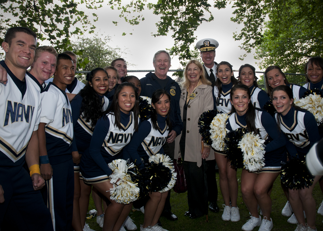 The Naval Academy Cheer Team with Secretary of the Navy and the USNA Superintendent.