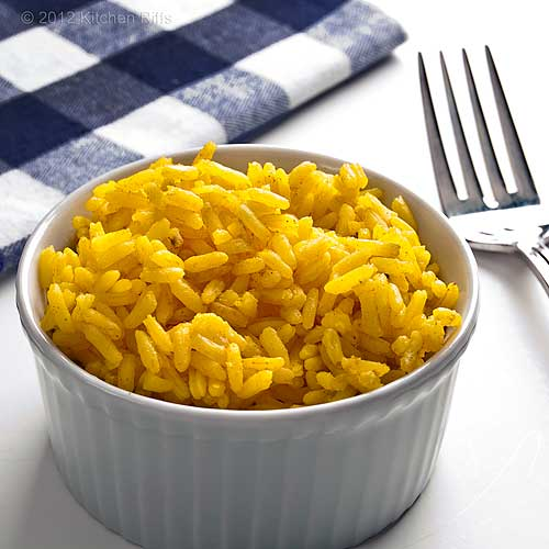 Aromatic Indian Yellow Rice in White Ramekin with Napkin and Fork