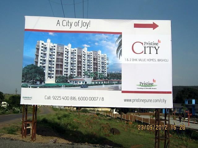 Hoarding at Site - Pristine City 20 Acre Township of 1 BHK & 2 BHK Flats at Bakori Wagholi Pune 412 207