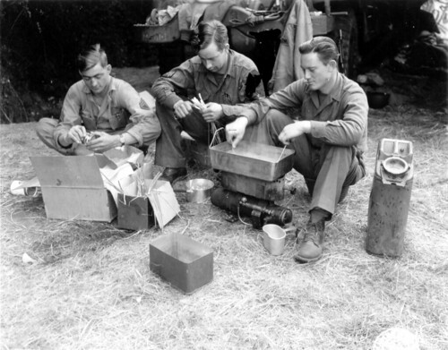 WWII Soldiers eating from aluminium canteens