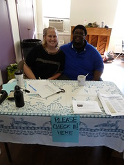 Mosaic volunteers Jeff and Anne at the welcome table
