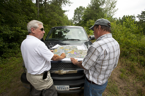 District Conservationist Nelson Brice and Kirby Wells discuss restoration plans for the 1,700 acre easement.