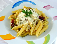 Penne rigate with courgettes, sun dried tomatoes a…