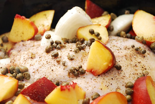 slow cooker whole chicken topped with peaches and onions