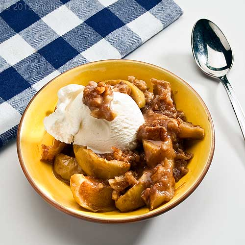 Walnut Apple Crisp with Ice Cream Garnish in Bowl with Napkin and Spoon