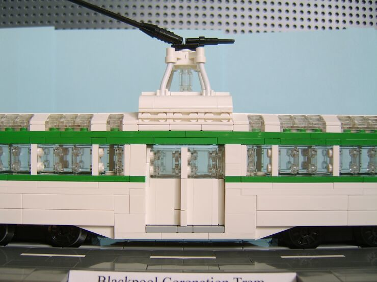 A close up from the side view showing the centre entrance doors and the trolley towerof a LEGO® model of a Blackpool Coronation tram