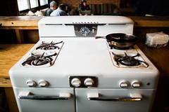 automobile(0.0), vehicle(0.0), table(0.0), white(1.0), gas stove(1.0), kitchen stove(1.0),