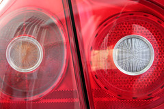 wheel(0.0), rim(0.0), grille(0.0), city car(0.0), alloy wheel(0.0), bumper(0.0), headlamp(0.0), spoke(0.0), automotive tail & brake light(1.0), automotive exterior(1.0), automotive lighting(1.0), red(1.0), light(1.0),