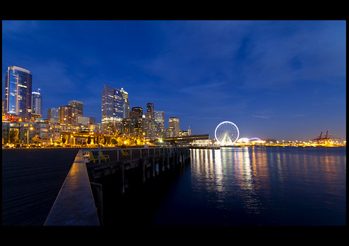 seattle urban reflection skyline cityscape waterfront dusk ferriswheel pugetsound bluehour bigwheel magichour downbythesea seattlesgreatwheel nzabh nzabhii