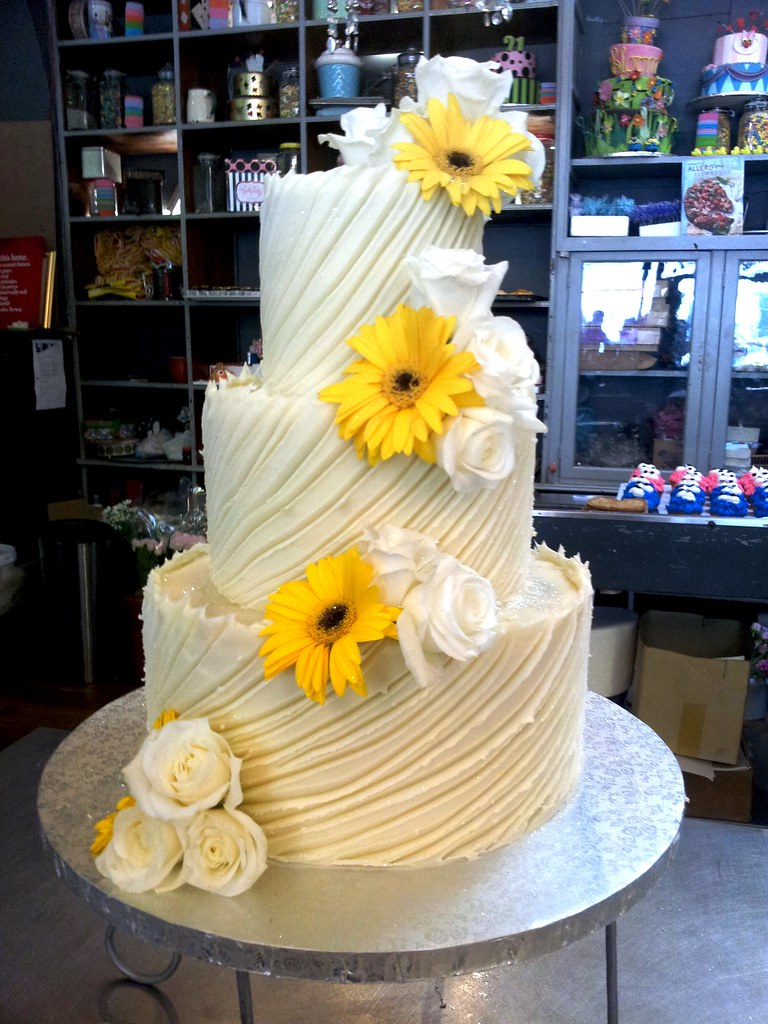 3-tier Wicked Chocolate wedding cake iced in Spanish textured white ...