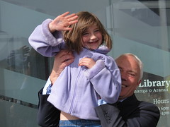 Mayor Bob Parker holds the girl who cut the ribbon