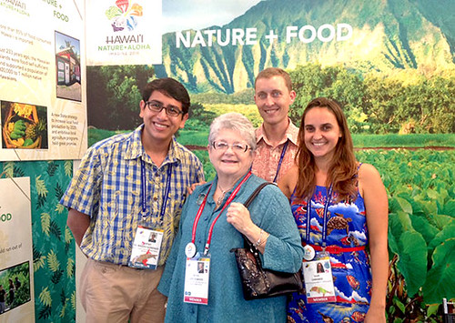 <p>At the Hawai'i IUCN booth, from left, Rodrigo Velasquez Gonzales, UH Alumni; M.R.C. Greenwood, University of Hawai'i president; Joshua Atwood, Hawai'i Invasive Species Council coordinator and Leah Laramee, Native Ecosystem Protection and Management section liaison</p>