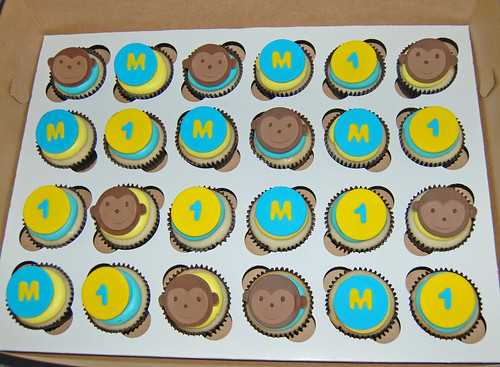 yellow and blue monkey 1st birthday cupcakes