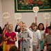Children invite the congregation to sing by UU World