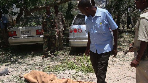 Somalia residents of north Mogadishu walked pass bodies killed in clashes between the US-backed AMISOM and local forces against the Al-Shabab resistance fighters. Despite the announcement that the Islamists are defeated the war continues. by Pan-African News Wire File Photos
