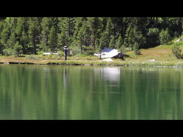 2316 Video of a fisherman having a peaceful afternoon fly-casting at Flower Lake