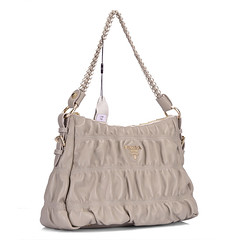 brown(0.0), bag(1.0), shoulder bag(1.0), hobo bag(1.0), handbag(1.0), beige(1.0),