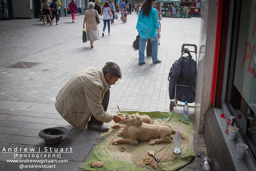Man making a sand dog