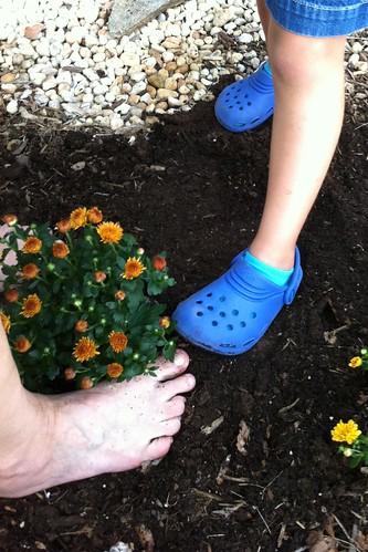 Mimi's & Catie's feet stomping dirt