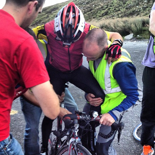 @crazyoldjim being lifted back onto the bike as he gears up for another night on the road @racearoundirl