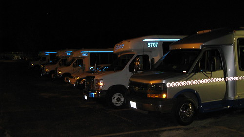 Paratransit buses in the rear parking lot at 5:40 AM.  Glenview Illinois.  September 2012. by Eddie from Chicago