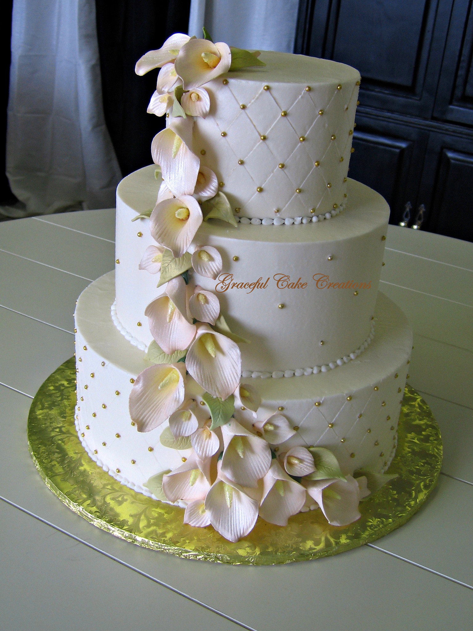 Elegant Ivory and Gold Wedding Cake with Champagne Colored