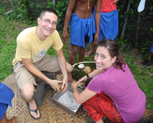 LTJG Sean Dolbow and LT Kristen Hahn scraping some coconuts to make cream.