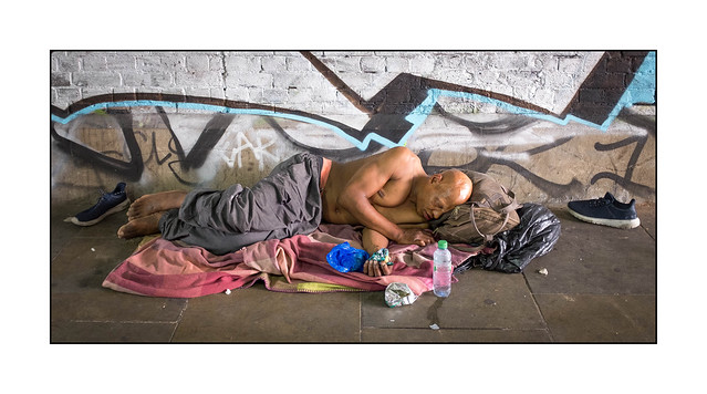 Homeless man at rest, East London, England.