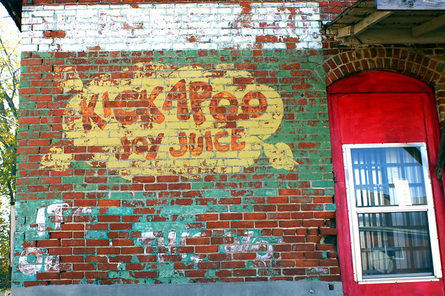 Kickapoo Joy Juice faded wall ad
