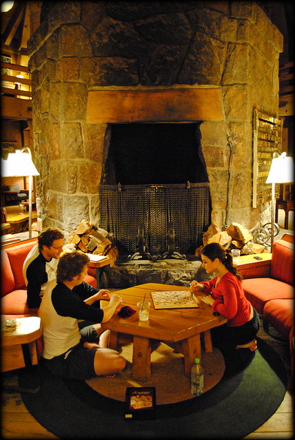 Guests playing a board game in the second floor lobby of the Timberline Lodge