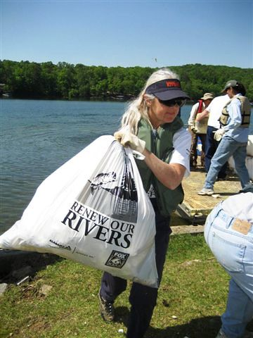 Volunteer Mimi Barkley of Houston, Ala., removes litter from the banks of Smith Lake during the Alabama Power Company's Renew Our Rivers campaign to clean-up Alabama Waterways in June 2008. Through the hard work of volunteers, approximately 180 tons of litter has been removed from more than 166 river miles within the Winston County area (Photo courtesy of LaVerne Matheson).
