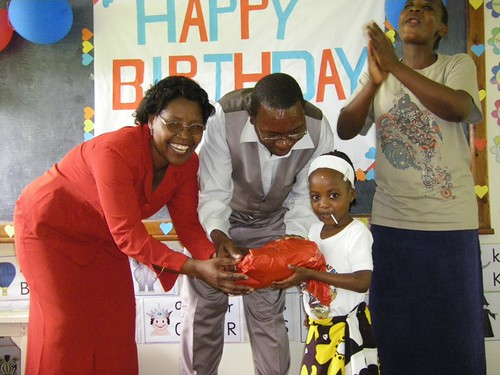 Kay Kodogo receives her present from her new parents