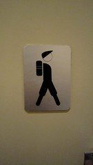 why does he have a backpack for the restroom?