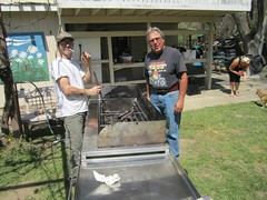 Marcus and Ahvo clean the grill