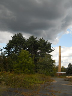 dark clouds by the smokestack