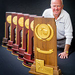 sp-12-0067 -- Athletic Director Denny Bridges poses with IWU's six NCAA national championship trophies.