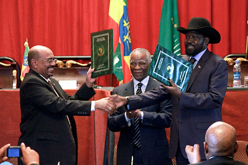 President of Sudan Omar Hassan al-Bashir, former South African President Thabo Mbeki and President Silva Kiir of South Sudan at a cooperation agreement celebration in Ethiopia. The two states have pledged to end differences. by Pan-African News Wire File Photos