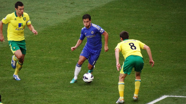 Chelsea's Eden Hazard takes on Norwich City's Jonny Howson