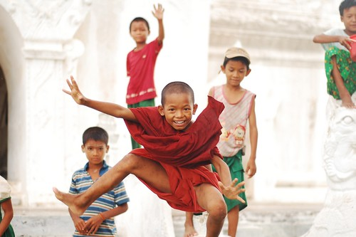 Kid monk in red robes  Myanmar