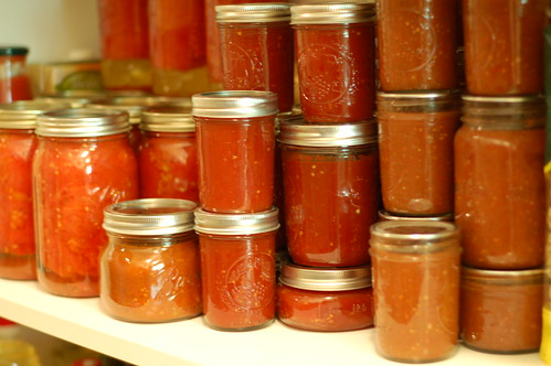 Canned tomatoes, tomato jam, and salsa line the pantry shelves by Eve Fox, Garden of Eating blog, copyright 2012