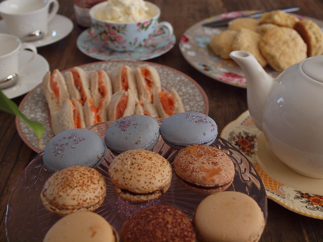 smoked salmon sandwiches, macarons, scones with the works