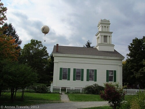 "The ""Intrepid"" flies over the Brooks Grove Methodist Church, Genesee Country Village & Museum, Mumford, New York"