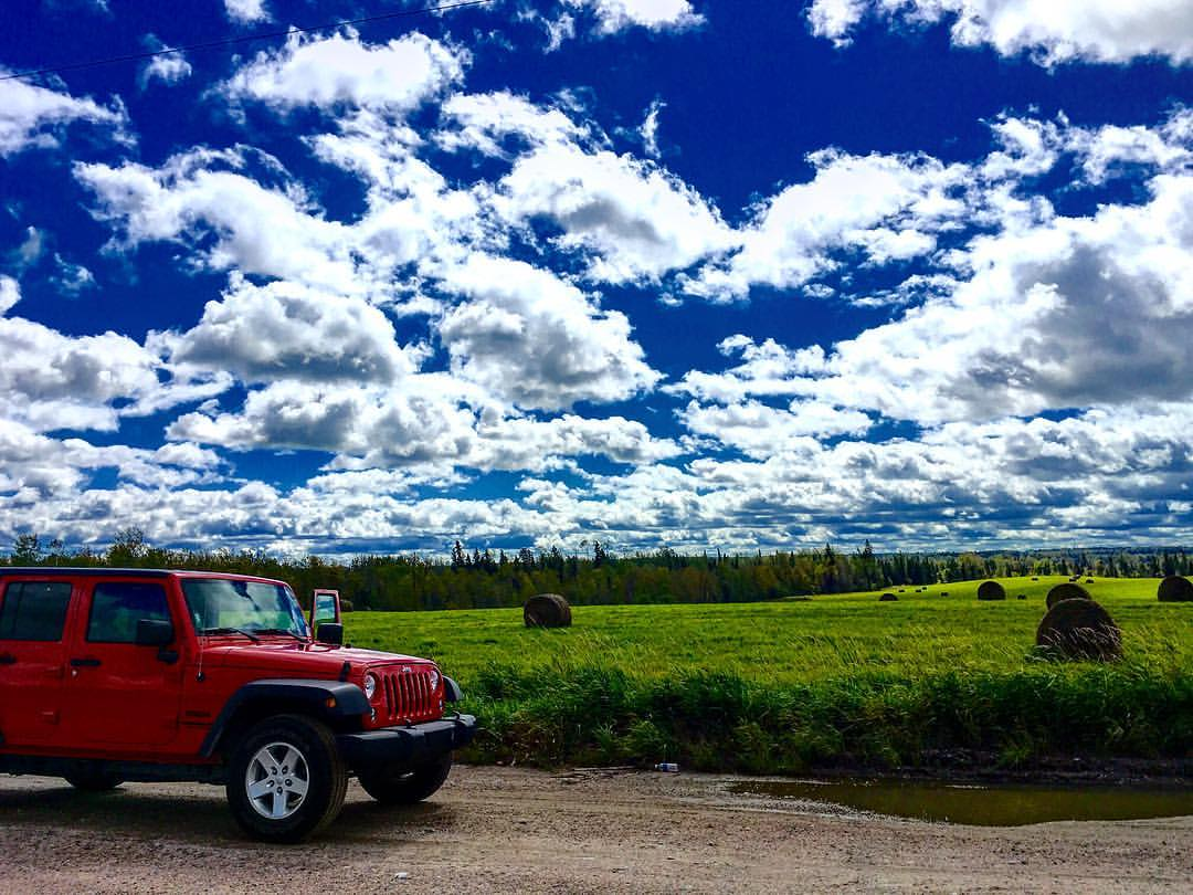 Good day for long driving. #canada #ontario #drive #jeep #red #blue #green #nature #backpacker #backpack #backpacking #trip #travel #roadtrip #clouds