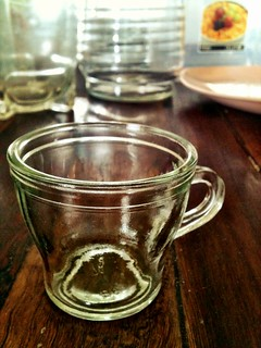 Tiny glass cup.