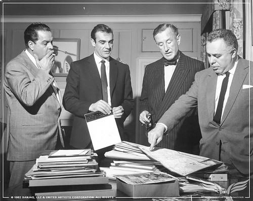 The Establishing Shot CUBBY BROCCOLI, SEAN CONNERY, IAN FLEMING & HARRY SALTZMAN STUDY A MAP OF JAMAICA WHILST SHOOTING DR. NO. © 1962 Danjaq, LLC & United Artists Corporation. All rights copy by Craig Grobler